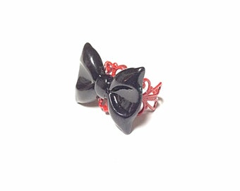Black bow ring, red filigree ring, red and black ring
