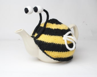 Bumble bee tea cosy. Hand knitted stripy bee cosie in washable yarn.