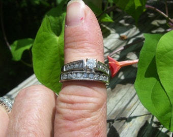 14 kt White gold and diamond wedding ring size 7