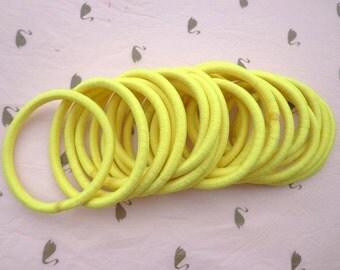 Sale--50 pcs yellow  hair elastics, ponytail elastics,ponytail holders,pigtail holders