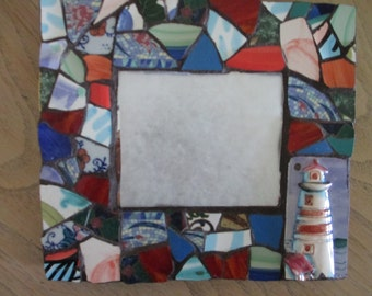 Nautical theme china mosaic mirror with lighthouse  grouted in very dark brown and brown painted base  SCRATCH SALE
