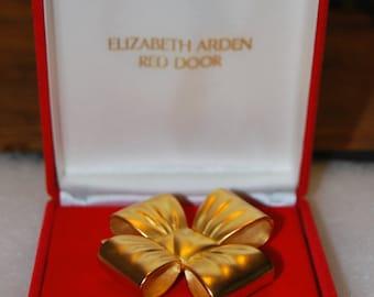 red door brooch by elizabeth arden