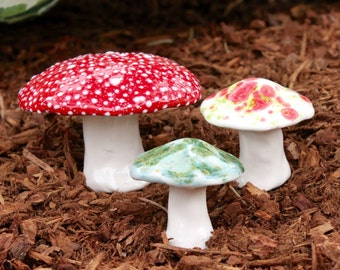 Three hand crafted ceramic toadstools - T84