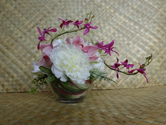 Tropical wedding centerpiece orchid peony
