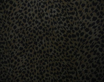 Leopard spots printed on camel colored suede
