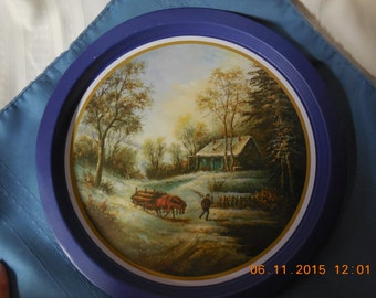 Currier and Ives tin, blue with winter scene on it.