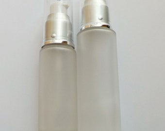 Frosted glass Bottles with white lotion pump, silver collar, and clear overcap