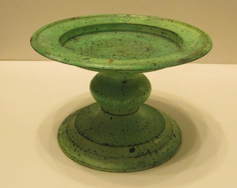 Shabby chic brass candle holder with painted green stain.