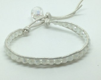 White bohemian wrap bracelet with leather cord and bead closure