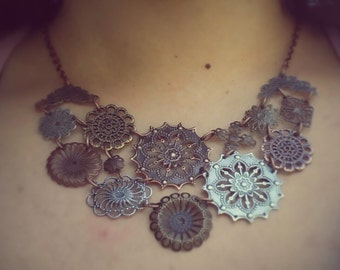 Multi disc, filigree, mixed metal bib necklace: Antiqued copper, brass & silver