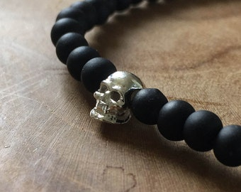 Black Silver Skull: an elastic beaded bracelet with silver skull and matte black glass beads.