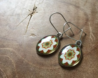 Mandala dangeling earrings: white, green, orange red. Oval.