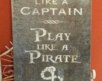 Work Like a Captain - Play Like a Pirate   metal wall art 16x24 inches