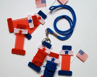 "Plastic Canvas: Sewing Helpers -- Yarn Bobbins, ""Stars and Stripes"" (set of 6 bobbins, lanyard and binder ring)"