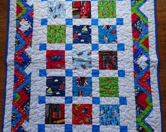 Transport themed brightly colored quilt/throw rug
