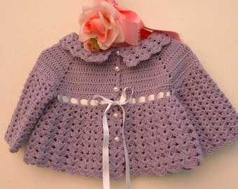 Hand crocheted baby sweater in pure lilac color. Crochet fashion romantic girl. Made to order