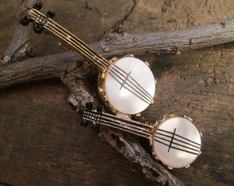 vintage gold tone faux mother of pearl twin metal banjo brooches