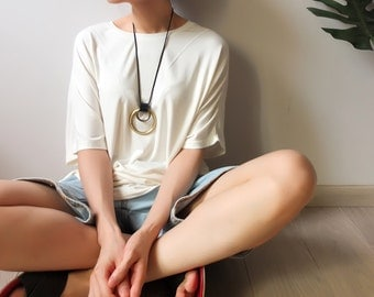 mixed material geometric necklace