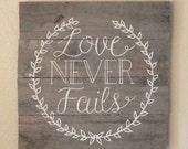 Love Never Fails Sign on Reclaimed Wood