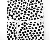 Woolf With Me™ Changing Pad Cover in White+Black Ink Spot
