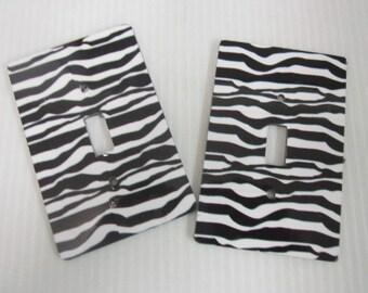 2 light switch covers, zebra design