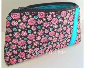 Black, pink and turquoise flower print makeup bag