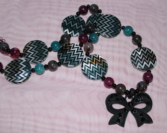 funky retro style bow necklace