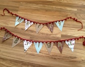 Banner made from paper and burlap pennants in a rustic primitive christmas style bunting with crochet pom pom garland and a touch of retro