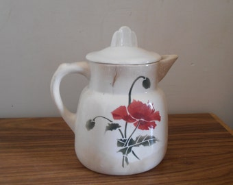 A French vintage pitcher with poppy decoration