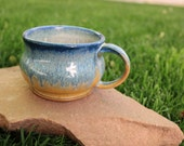 Runny blue and orange mug