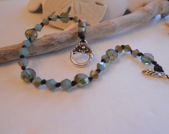 Hand knotted glass bead bracelet with toggle clasp