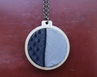Blue charity necklace.