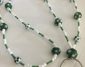 Green and white poka dot lanyard