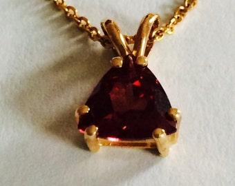 14k yellow gold garnet pendant with chain;  trillion garnet-6 x 6 x 6 mm; 2.3 grams; January birthstone