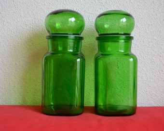 Two vintage square apothecary jars with bubble lid made of green glass