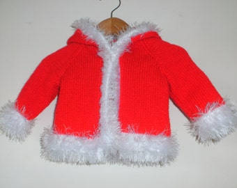 Hand knitted fur trimmed hooded coat
