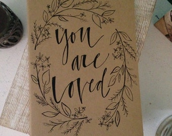 "Handmade Moleskine Journal w/ ""You are Loved"" lettering and design"