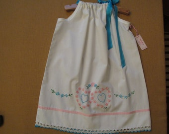 Embroidered pillowcase dress with pink hearts and flowers on a white vintage cotton pillowcase in girls size 5.