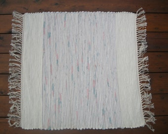 Pretty pastel rug woven with new fabric, on family antique rug loom.