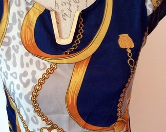 1980's designer style gold , blue and white v neck top