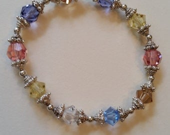 Stretch bracelet made with Swarovski crystals and terming Silver spacers