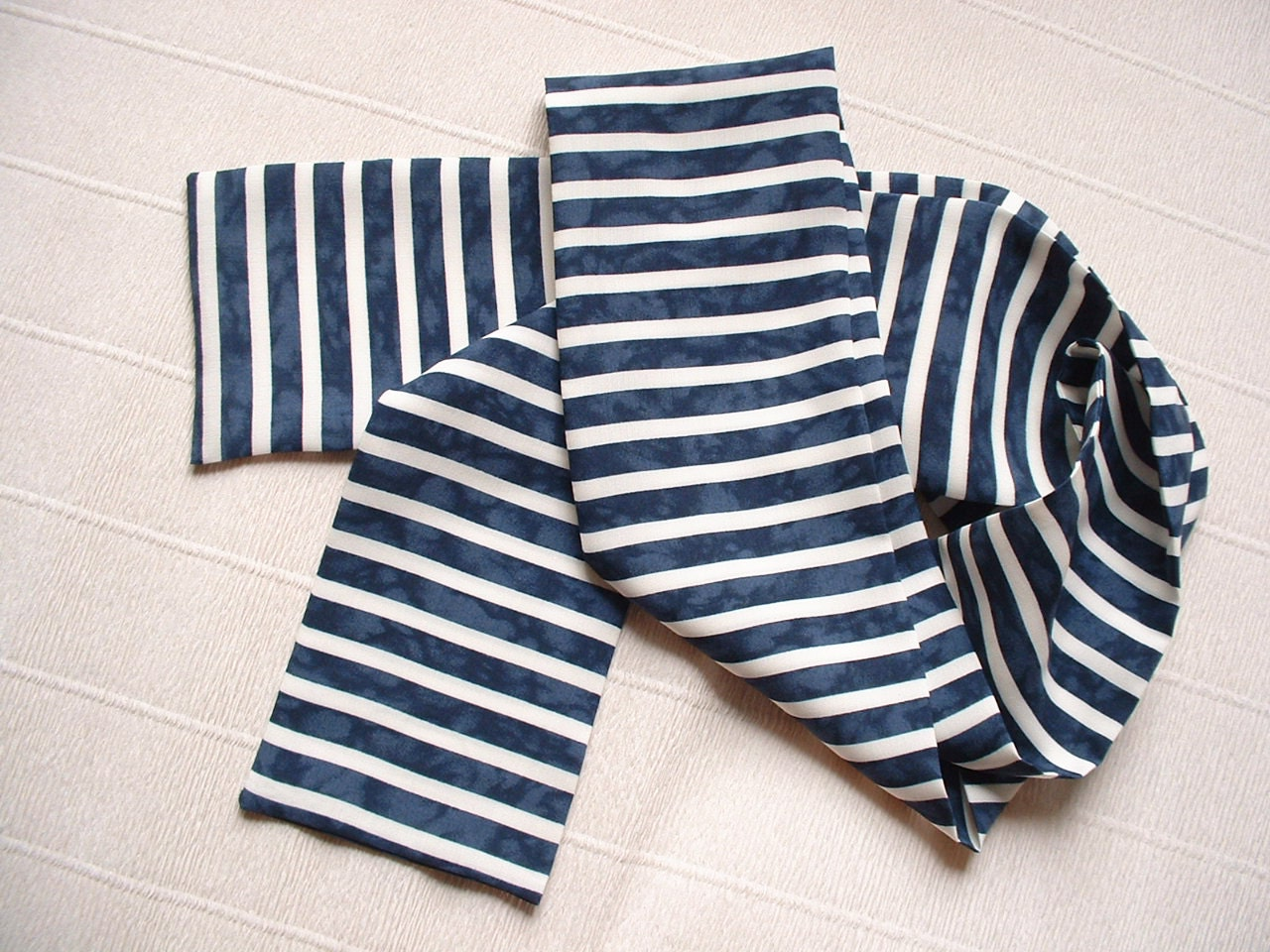 This classic stripe-print scarf is made from a gauzy lightweight fabric so you can wear it anytime, anywhere. It can double as a sarong. Seller assumes all responsibility for this listing.