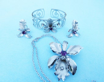 Items similar to vintage bugbee niles orchid earrings on for Bugbee and niles jewelry