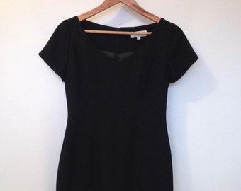 Cue little black dress