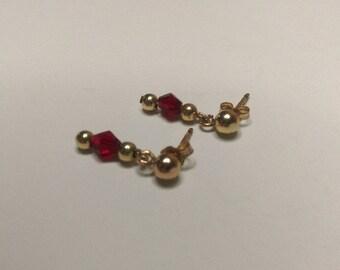 Swarovski ruby crystal gold stud earrings