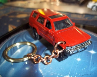 custom made keychain 1985 toyota 4 runner,gloss red w/black mags/repaint-hand made heavy duty chain and jump rings/mint