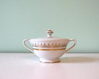 white ceramic sugar bowl with gold patterns