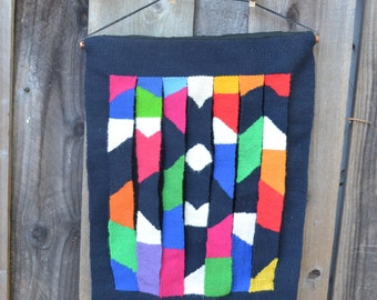 Vintage Woven Wall Hanging, Vibrant Colors Against a Black Background, Geometric Design