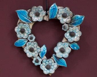 Raku-fired ceramic heart with flowers