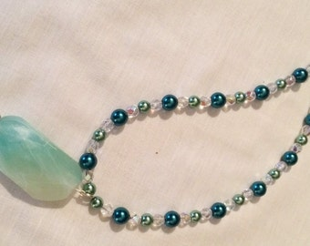 Turquoise color pendant necklace